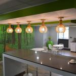 Flexible Workspace Kitchen Area With Forest Themed Wallpaper